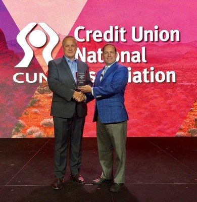 CUNA President and CEO Jim Nussle (left) presents James Schenck, President and CEO of PenFed Credit Union, with the 2017 Credit Union Hero of the Year Award at CUNA's annual conference. Download photo: http://bit.ly/2seK7b9