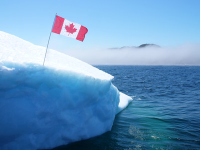 It's cool to be Canadian as evidenced by this Canadian flag proudly erected on one of Canada's natural wonders, an iceberg. Newfoundland sailors staked Canada's claim to one of the hundreds of majestic frozen giants floating through Iceberg Alley with a flag that showcases 150 reasons why it's cool to be Canadian. These reasons were gathered by Canadians leading up to the Iceberg Vodka Ice-Bus Tour taking place this week, which is transporting a 20,000 year-old iceberg from Newfoundland to Ottawa in celebration of Canada's sesquicentennial.  https://app.box.com/s/aifni5wm6hak8275enitaex6zenwdkw5 (CNW Group/Iceberg Vodka)