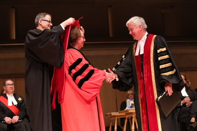 Law Society Treasurer Paul Schabas (right) confers the title of Doctor of Laws, honoris causa, LLD, on Sheila Watt-Cloutier, OC, while she receives the LLD hood from Law Society Bencher Christopher Bredt, at the Call to the Bar ceremony in Toronto on June 26. Sheila Watt-Cloutier received the honorary degree for her outstanding efforts to secure global health, justice and the cultural survival of the Inuit and Arctic Indigenous peoples who are most vulnerable to the impacts of climate change. The Law Society awards honorary doctorates to distinguished people in recognition of outstanding achievements in the legal profession, the rule of law or the cause of justice. Recipients serve as inspirational keynote speakers for the new lawyers attending the Call to the Bar ceremonies. (CNW Group/The Law Society of Upper Canada)