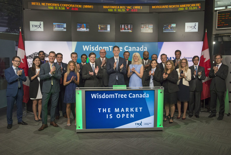 Kurt MacAlpine, Executive Vice President, Head of Global Distribution, WisdomTree Asset Management, joined Dani Lipkin, Head, Business Development, Exchange Traded Funds, Closed-End Funds, and Structured Notes, TMX Group, to open the market to launch two new Exchange Traded Funds (ETFs): WisdomTree Yield Enhanced Canada Short-Term Aggregate Bond Index ETF (CAGS); and WisdomTree Yield Enhanced Canada Aggregate Bond Index ETF (CAGG). Headquartered in New York, WisdomTree Investments through its subsidiaries in the U.S., Canada, Europe and Japan, is an exchange-traded fund and exchange-traded product sponsor and asset manager. CAGS; and CAGG; commenced trading on Toronto Stock Exchange on June 26, 2017. (CNW Group/TMX Group Limited)