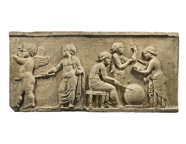 A large and fascinating Classical Greek relief with a scene depicting the three daughters of Zeus grouped around a celestial globe spinning the threads of human destiny. They were named Clotho (Spinner), who spun the thread of human fate, Lachesis (Allotter), who dispensed it, and Atropos (Inflexible), who cut the thread, thus determining the length of a person's life and the moment of their death.