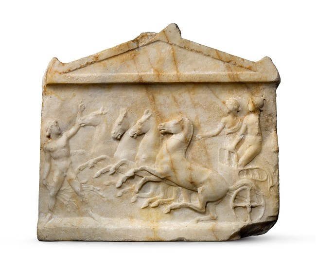 This Apobates Race relief is a world class Greek masterpiece depicted an athlete in a race, which consisted of leaping on and off a quadriga (chariot of four horses) while it continued racing. The apobates races represented the main attraction of the Panathenaic games in Athens, where they were introduced by the legendary King Erichthonius and are found on the Parthenon.