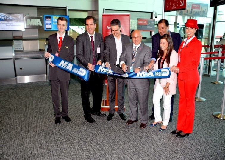 From left: GMCVB Executive Vice President Rolando Aedo (second from left), Miami-Dade Aviation Department Chief of Staff Joseph Napoli (center) and Avianca Brasil staff and flight crew cut the ribbon at the June 26 MIA celebration. Click here for hi-res images http://news.miami-airport.com/mia-celebrates-launch-of-so-paulo-service-by-avianca-brasil/