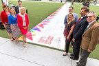 Mayor Bonnie Crombie and City Councillors pose for a photo as the City of Mississauga attempts a Guinness Book World Record for biggest birthday card to celebrate Canada's upcoming 150th birthday on June 27, 2017 at Celebration Square in Mississauga, Canada. (Photo by Adam Pulicicchio) (CNW Group/City of Mississauga)