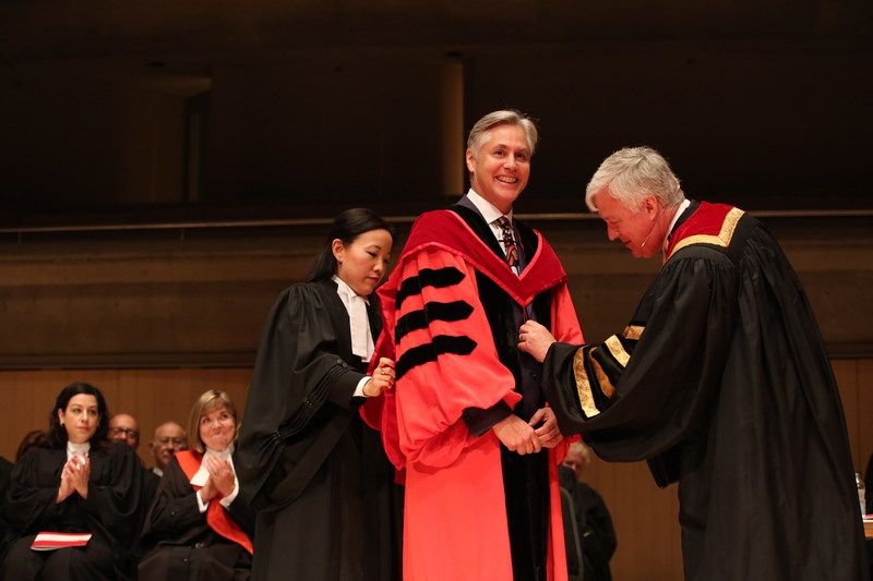Dr. John Borrows (centre) received an honorary LLD from the Law Society at the morning Call to the Bar ceremony in Toronto on June 27 at Roy Thomson Hall. Here, Law Society Treasurer Paul Schabas (right) and Law Society Bencher Sandra Nishikawa (left) adjust the LLD hood. Dr. John Borrows received the honorary LLD from the Law Society in recognition of his work as a champion for First Nations and Indigenous rights and freedoms. The Law Society awards honorary doctorates to distinguished people in recognition of outstanding achievements in the legal profession, the rule of law or the cause of justice. Recipients serve as inspirational keynote speakers for the new lawyers attending the Call to the Bar ceremonies. (CNW Group/The Law Society of Upper Canada)