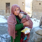 Fatima, 34, holds her baby boy after visiting a UNICEF-supported mobile health team in the remote village of Ali-Beig, Afghanistan. He had been running a fever and received the medications he needs. Fatima would not have been able to take him for treatment on her own: the nearest health facility is more than a four-hour drive away. © UNICEF/UN068818/Karimi (CNW Group/UNICEF Canada)