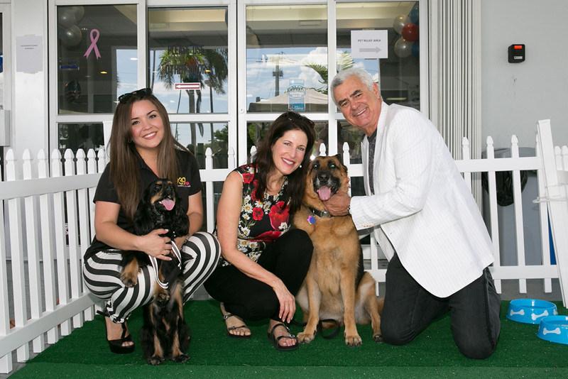 Craig and Martine Zinn and their dog Desa, with 939 Mia Radio Personality GiGi Diaz and her pup Lia enjoying the Subaru of Pembroke Pines Dog Appreciation Pawty.
