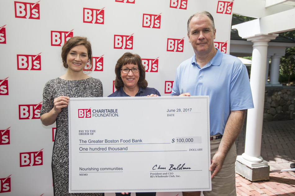 Chris Baldwin, President and Chief Executive Officer, BJ's Wholesale Club, presents Mackenzie Maher-Coville, Foundation Relations Manager, and Cheryl Schondek, Vice President, Food Acquisition and Supply Chain, of The Greater Boston Food Bank with a grant for $100,000 to support the distribution of perishable foods.