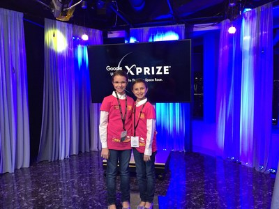 Delaney Robertson (left) and Hadley Robertson (right) at the 2015 Google Lunar XPrize Moonbots Challenge in Tokyo, Japan.