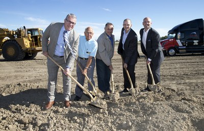 Lance Trumble, Managing Director for Tribal Partners; Earl Solberg, Rocky View County Deputy Reeve; Greg Boehlke, Rocky View County Reeve; Stephen Stewart, Whirlpool's Director Supply Chain and CN's Assistant Vice President of Intermodal Andrew Fuller break ground Wednesday on Whirlpool Canada's new distribution centre at CN's Calgary Logistics Park. (CNW Group/CN)