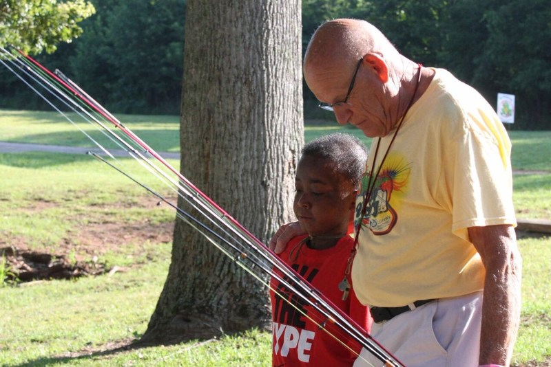 Tron Foster, who has struggled with bone cancer since he was six, and Tom Russell have formed a special relationship through Camp Victory, an annual summer camp sponsored by The Children's Security Blanket (CSB), a Spartanburg, SC based nonprofit providing support for children battling cancer co-founded by Russell. Tron will miss camp this July due to surgery scheduled to amputate his leg so Russell and CSB are holding a special camp just for him complete with his favorite pastime - fishing!