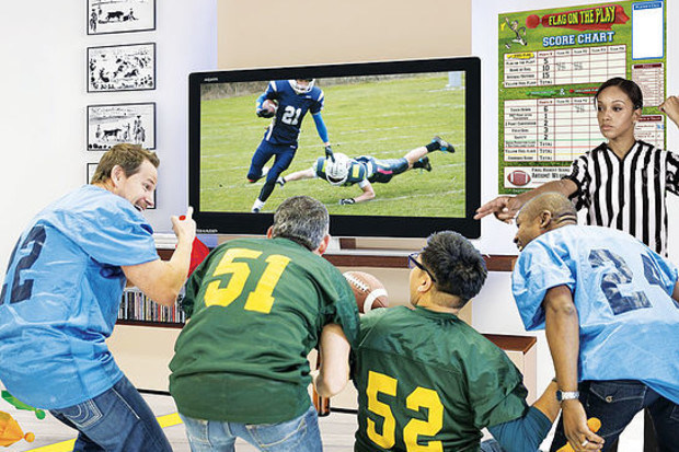 """A brand-new and exciting football wall-board game you play while watching a real-time football game on TV. First-ever """"Interactive Football Experience""""."""