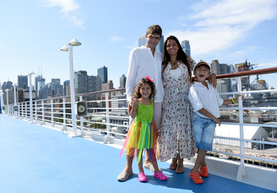 """Oceania Cruises recognizes 4-year-old Lorenna D'Amore Nogueira and her brother, 6-year-old Henrique D'Amore Nogueira, as the """"Youngest World Cruisers,"""" as they pose with their parents Drielle and Diego on the deck of m/s Insignia while docked in New York, Wednesday, June 28, 2017, during its 180-day Around the World sailing. (Photo by Diane Bondareff/AP Images for Oceania Cruises)"""