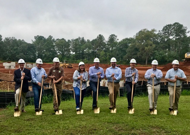 Representatives from SageSure Insurance Managers, Summit Group Commercial Properties and Mad Dog Construction prepare to break ground for SageSure's new 20,000-square-foot office in Tallahassee.