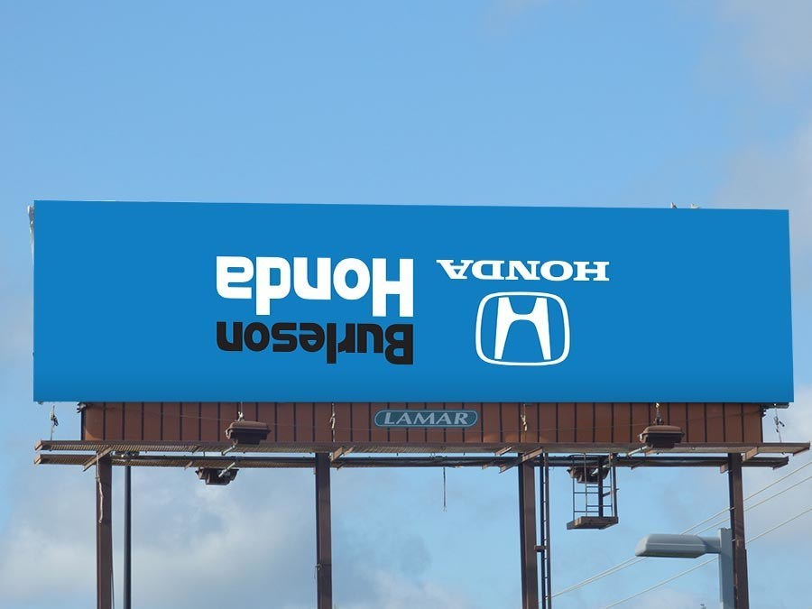 General Manager, Justin Crain, and new ownership at Burleson Honda attempting to turn things upside down, including their billboards.