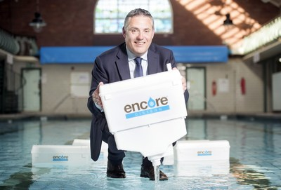 Encore Director David Davis with Encore cisterns that would save hotels so much water they would fill numerous Olympic swimming pools.  Credit Adrian Sherratt Photography. (PRNewsfoto/Encore)