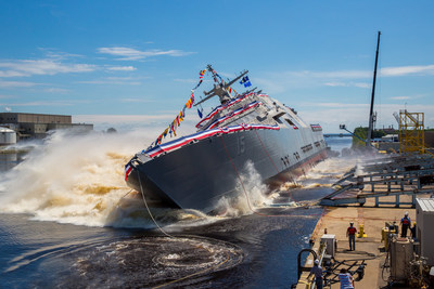 The 15th Littoral Combat Ship, the future USS Billings launches sideways into the Menominee River in Marinette, Wisconsin, on July 1. Once commissioned, LCS 15 will be the first ship to carry the name of Billings, Montana.