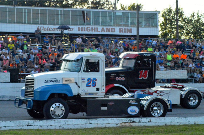 """Bandits Travis Buckner (#26) and Ricky Rude (#14) battle for position at Highland Rim Speedway, Saturday, July 1st."""