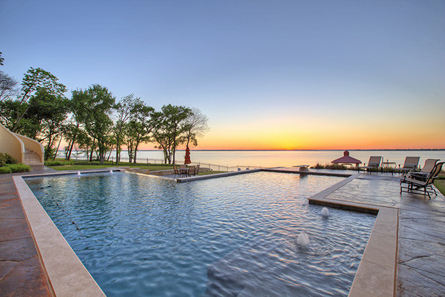 "Platinum Luxury Auctions has announced that this impressive lakefront estate just outside of Dallas, TX is scheduled for sale at *luxury auction*® on July 14th. Recently offered for $4.75 million, the home will now be sold to the highest bidder at or above a price of only $1.5 million. Built in 2015, the home features unique bells and whistles such as a ""hidden"" wine cellar and SmartHome technology throughout. Discover more at LakefrontLuxuryAuction.com."