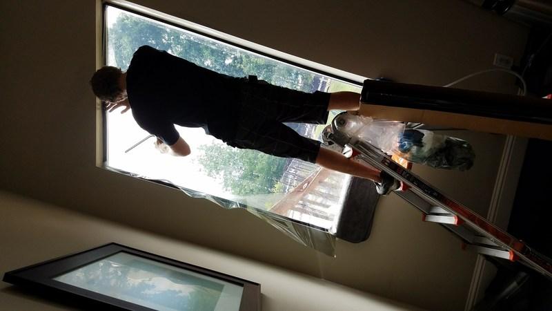 Michael Richardson tinting a residence window