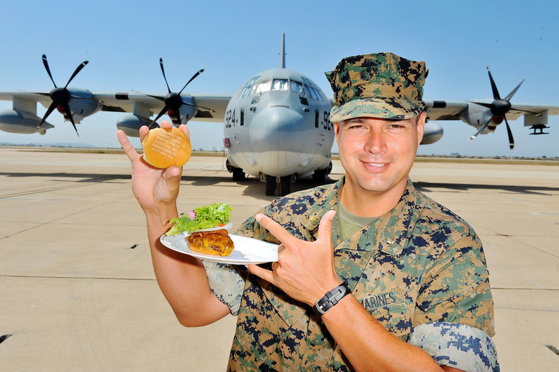 Military personnel enjoy ThankYouBurgers from Carnival Cruise Line during the first social media powered barbecue.