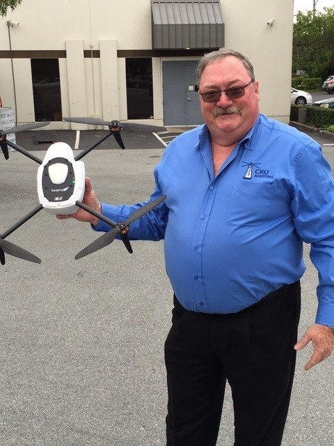 Glenn Smith, Vice President, CRU Adjusters, holds a Kespry Drone.