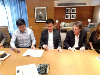 Representatives of BCG, Unisun Energy, and Coara Solar at the signing ceremony.