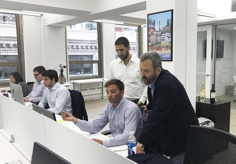 Former Prime Minister Ehud Barak chats with Carbyne employees