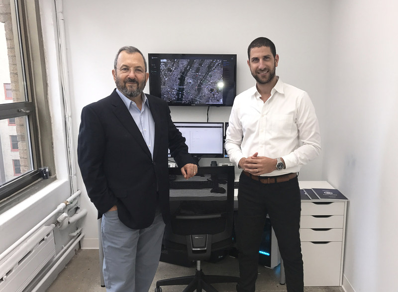 Former Prime Minister Ehud Barak (left) with Carbyne President Amir Elichai in front of the Reporty ecosystem for 911 and 311 services.