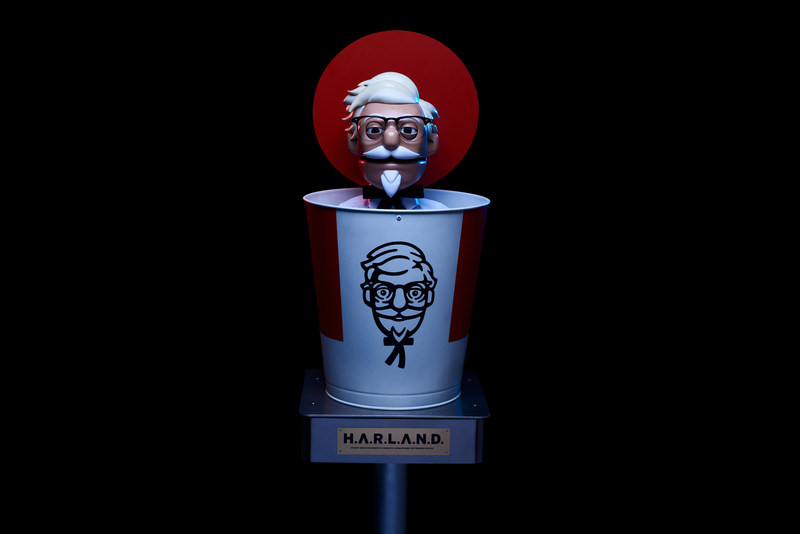 To celebrate National Fried Chicken Day, Kentucky Fried Chicken®& is bringing founder Colonel Harland Sanders to the drive-thru experience as robot chicken-expert H.A.R.L.A.N.D. (Human Assisted Robotic Linguistic Animatronic Networked Device).