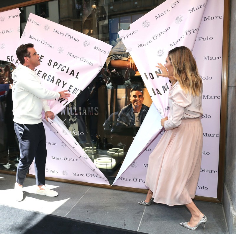 Robbie & Ayda Williams unveil the shop window of the Marc O'Polo Munich Flagship Store where their Special Sweatshirt Edition was launched. (PRNewsfoto/Marc O'Polo)