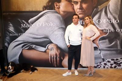 """Robbie & Ayda Williams present their collection at the Marc O'Polo Munich Shop. Also present: their dog """"Mr. Showbiz OBD"""". (PRNewsfoto/Marc O'Polo)"""