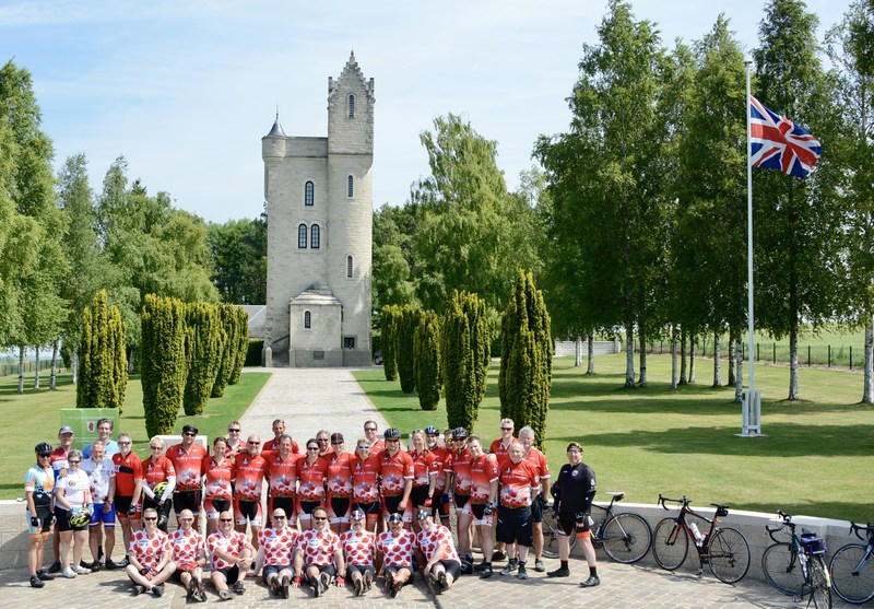 Canadian Riders from the 2017 Battlefield Bike Ride pose in front of the  Ulster Memorial Tower in Thiepval, France on the same day the cheque was presented. (CNW Group/Wounded Warriors Canada)