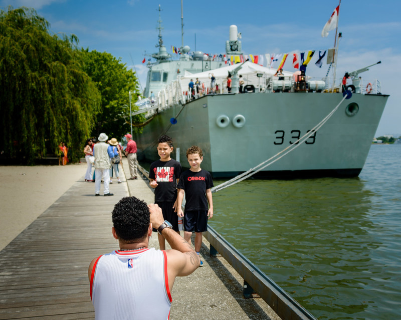 These two young men are about to tour the RCN, HMCS Toronto at Sherbourne Common which was open for public tours at the Redpath Waterfront Festival, July 1-3.  Photo by Jim Orgill (CNW Group/Water's Edge Festivals & Events)