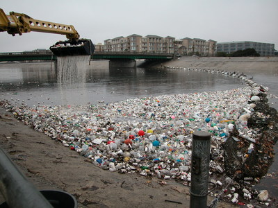 Plastic trash collects at the mouth of the Los Angeles River in Long Beach in the 2002 photo. Nineteen top aquariums today (July 10) launched a nationwide consumer campaign and a business commitment to drive a shift away from single-use plastic among their visitors, in their communities and beyond. The campaign addresses the grave threat posed to aquatic wildlife by plastic pollution. Credit: © Bill McDonald, Algalita Foundation