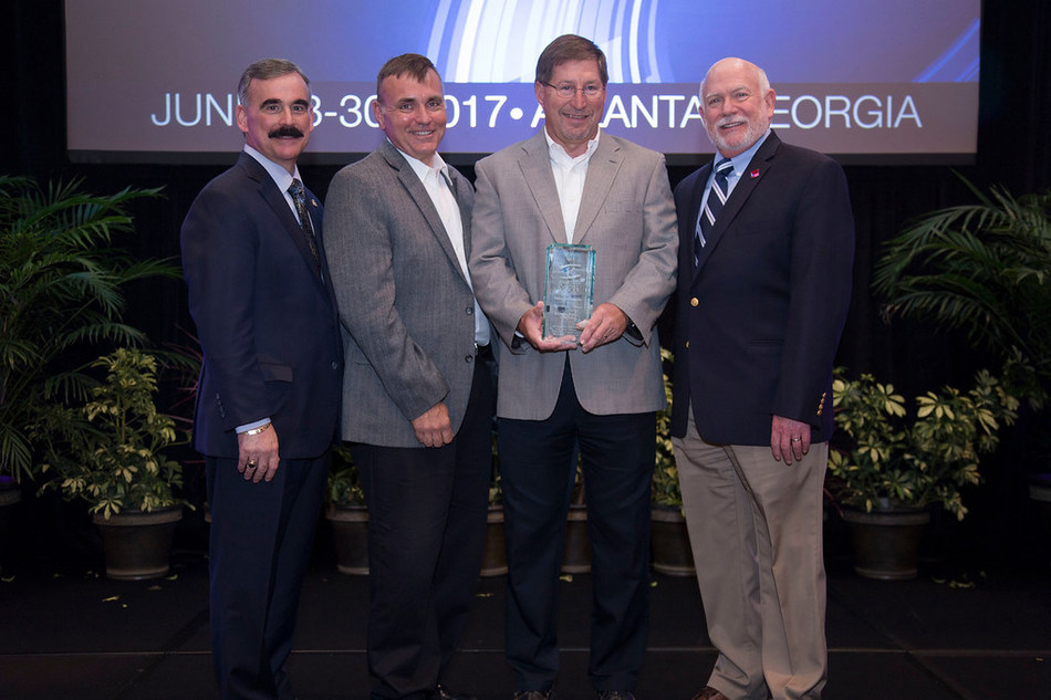 The Southeastern Electric Exchange, Inc. (SEE) recognized the Eight Flags Energy Combined Heat and Power Plant as a 2017 Industry Excellence Award winner. From left: Bryan Olnick, VP Operations, Florida Power & Light and Chairman, Engineering & Operations Committee for SEE; Warren DiNapoli, Sr. Operations Manager Northeast & Northwest Division, Florida Public Utilities; Mark Cutshaw, Director, Business Development & Generation, Florida Public Utilities; and Jim Collins, Executive Director, SEE.
