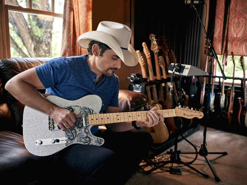 GRAMMY® Award-winning and multiplatinum-selling country music superstar, singer, and celebrated guitarist Brad Paisley with his Fender artist signature guitar: the Fender Brad Paisley Road Worn® Telecaster®.