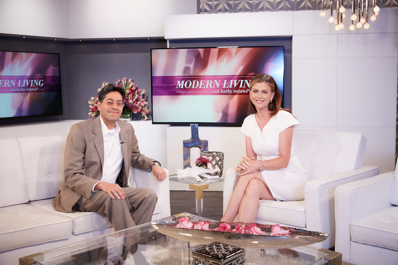 Dipak Golechha, CEO of Excelligence Learning Corporation, in the studio with Kathy Ireland during the E! sponsored news interview on Modern Living with kathy ireland.