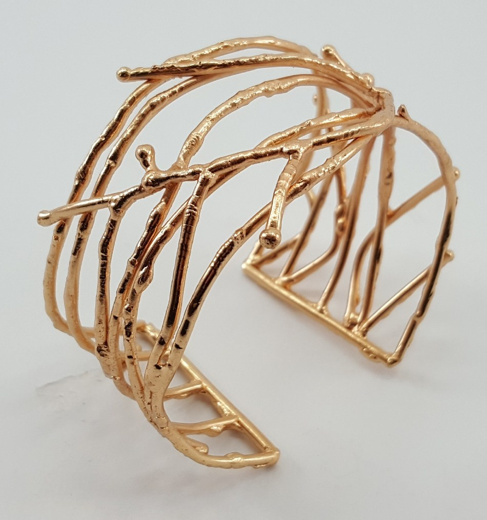 """The adjustable 2 1/2"""" x 2 1/2"""" x 1 1/2"""" cuff is brass with gold-colored plating. Credit: Gifts With a Cause"""