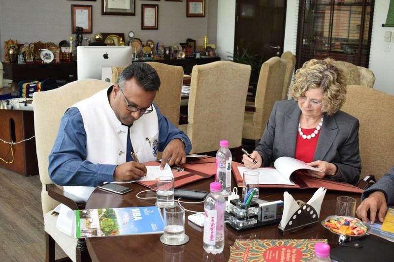 JGU Vice Chancellor Prof (Dr.) C Raj Kumar and Dr. Idalene Kesner, Dean, Kelley School of Business, IU signing the MoU (PRNewsfoto/Jindal Global Business School)
