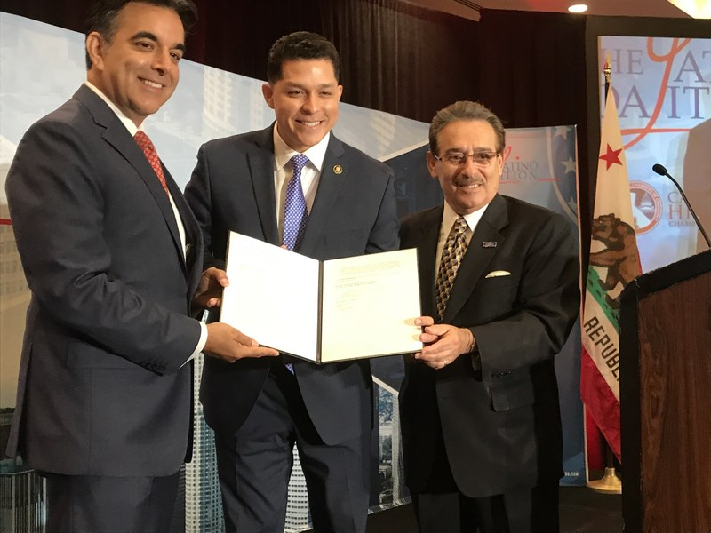 MBDA Acting National Director Chris Garcia (center) is joined by Hector Barreto, Chairman of The Latino Coalition (left), and Manny Rosales, Executive Director of The Latino Coalition (right), at the West Coast Economic Summit in Los Angeles, CA where a memorandum of understanding to strengthen ties between the Federal Government and Latino business leaders was signed on June 29. (Photo by MBDA)