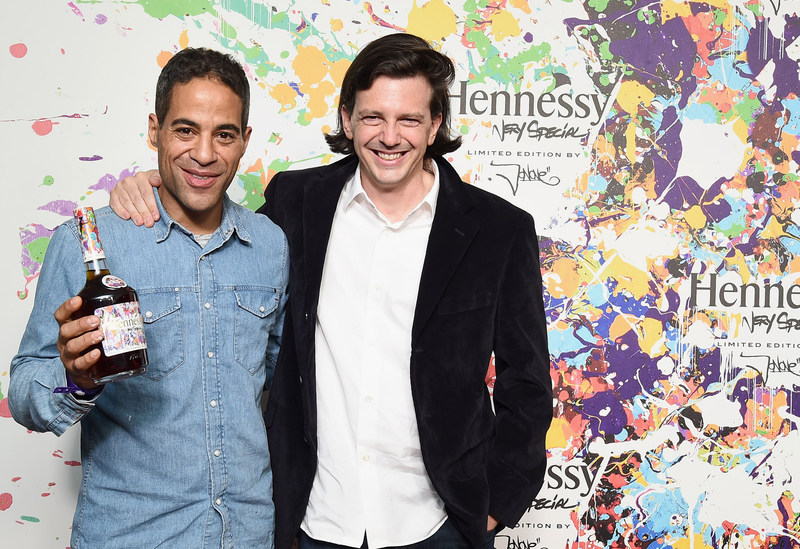 NEW YORK, NY - JULY 11: Street-artist-turned-art-world phenomenon, JonOne and artist Ryan McGinness attend the Hennessy V.S Limited Edition by JonOne Launch Party at Terminal 5 on July 11, 2017 in New York City. The Limited Edition release by urban artist JonOne, which features a colorful, vibrant design, is the seventh in an ongoing series of collaborations between Hennessy V.S and several internationally renowned artists. (Photo by Ilya S. Savenok/Getty Images for Hennessy)