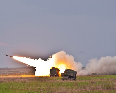 A Lockheed Martin GMLRS practice round blasts away from a HIMARS launcher during U.S. Army exercises at Fort Riley, Kansas.