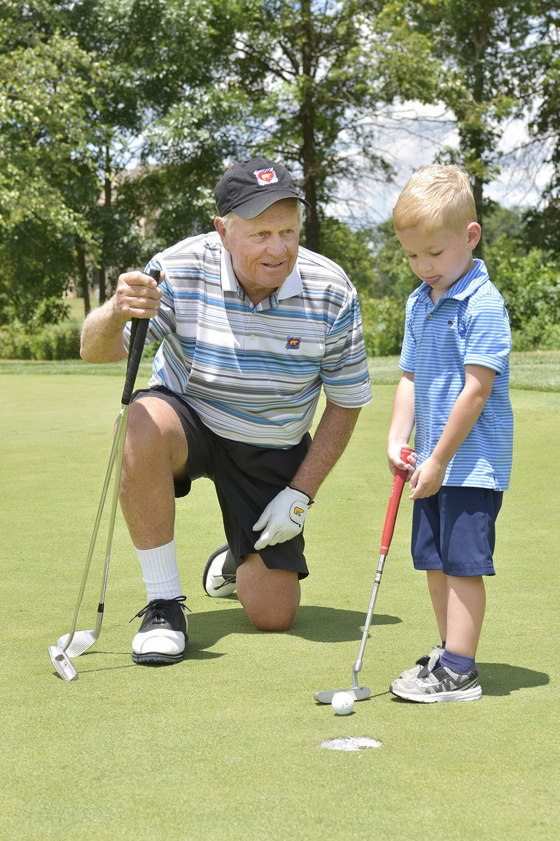 Jack Nicklaus and Hudson Elkins practicing their putting at the 2017 Creighton Farms Invitational.
