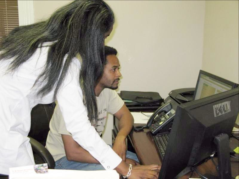 Helen Callier coaching T. Lockett, President of Operation Green Recycling in a one-on-one session