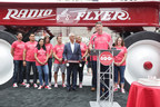 Radio Flyer CWO Robert Pasin and Chicago Mayor Rahm Emanuel celebrate Radio Flyer's 100th anniversary in Chicago on July 13, 2017. (Peter Wynn Thompson/AP Images for Radio Flyer)
