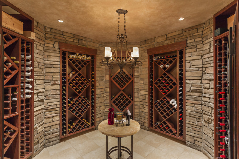 A climate-controlled, 700-bottle wine room is one of the many features of the estate's lower level, which is outfitted as an entertainment space offering a pub-style bar, billiards, fitness center, home theater, lounge and cigar room. Learn more at PennLuxuryAuction.com.
