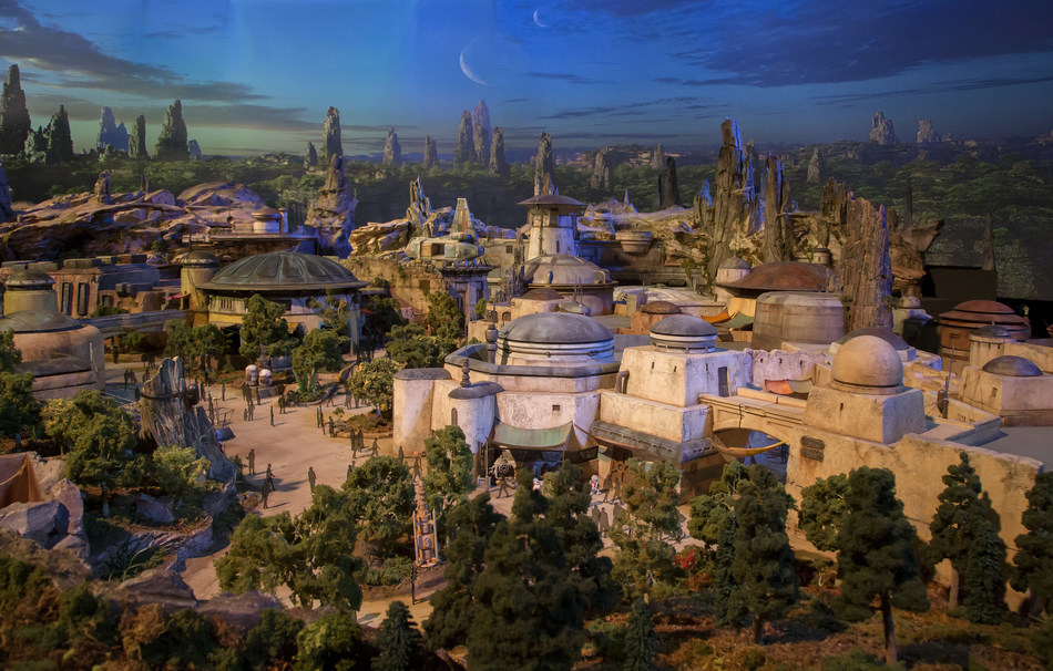 """Today at D23 Expo 2017, Walt Disney Parks and Resorts Chairman Bob Chapek unveiled the epic detailed model of the Star Wars-themed lands coming to Disneyland park and Disney's Hollywood Studios, which will remain on display throughout the weekend as part of """"A Galaxy of Stories"""" pavilion."""