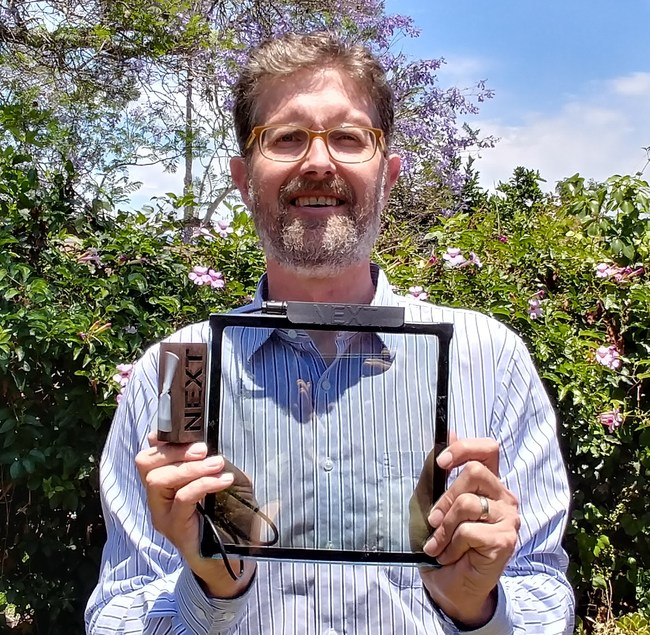 "NEXT CTO, Corey Hoven holds an 8""x 8"" functional prototype."