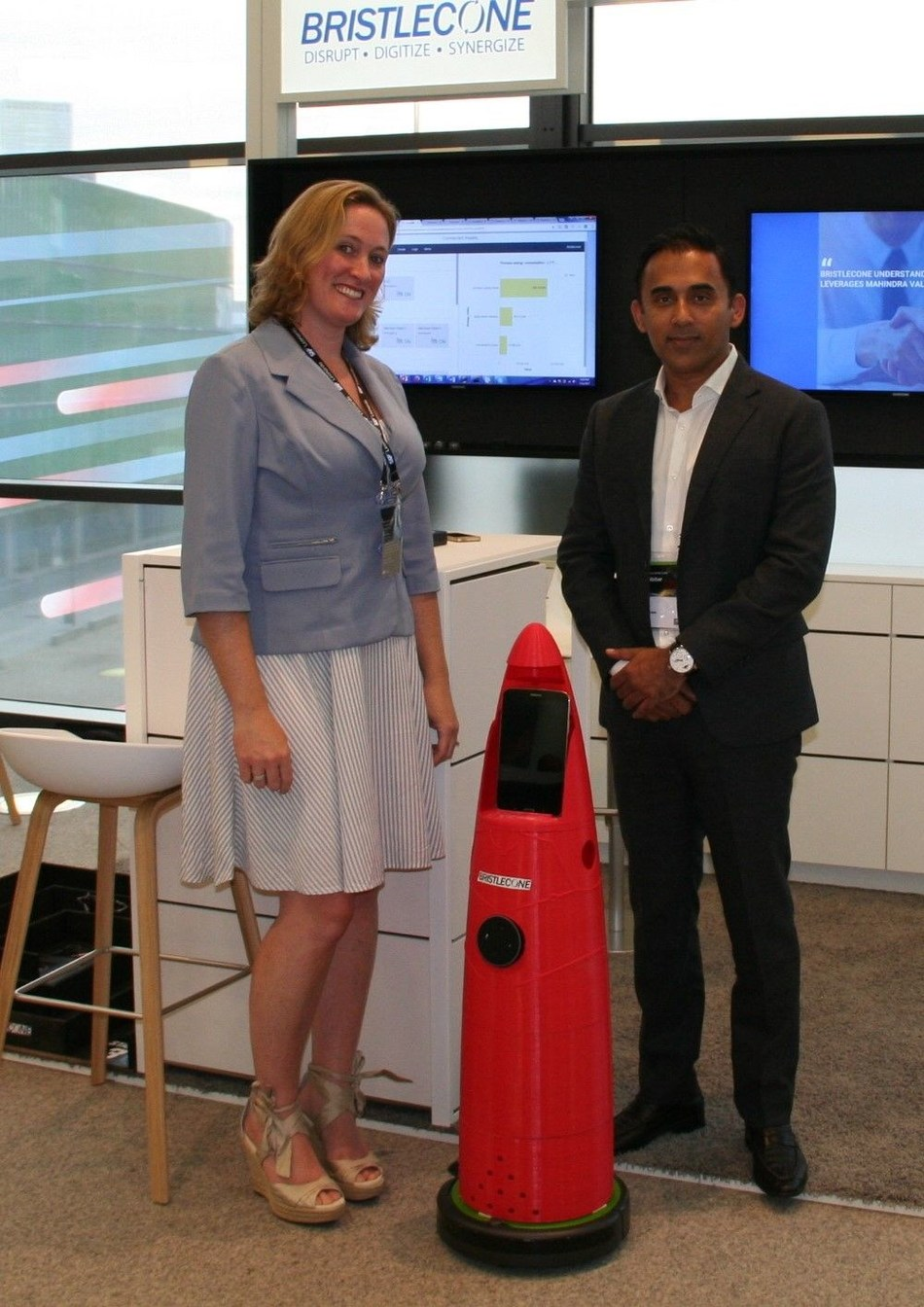 (From Right to left) Irfan Khan, President and CEO, Bristlecone, with HARI and Rebecca Nerad, Head of Global Marketing and Alliances (PRNewsfoto/Bristlecone Inc.)